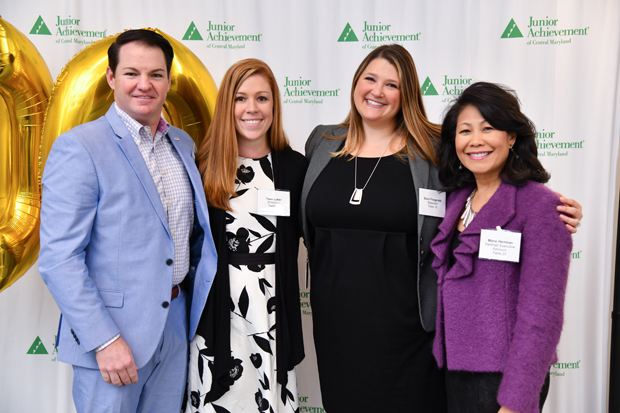 From left, Mick Arnold, president of Arnold Packaging; Tami Luber, a paralegal with State Farm; Staci Fitzgerald, an attorney with State Farm; and Marie Hartman, executive vice president of Hartman Executive Advisors, are all smiles at the annual Leading Ladies event. (Photo by Maximillian Franz)