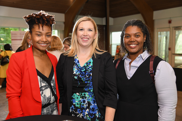 Christen Johnson, founder and head stylist at SophisticatedChic Brand LLC; Laura Stoner, operations manager with Greenspring Advisors LLC; and Roberta King Jones, an assistant branch manager with Fidelity Investments, enjoy the Path to Excellence networking event. (Photo by Maximilian Franz)