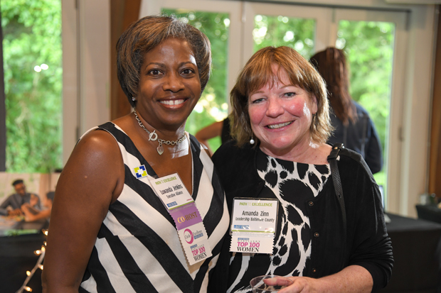 Top 100 Women Luwanda Jenkins, left, director of Executive Alliance, gets a photo with Amanda Zinn, president and CEO of Leadership Baltimore County. (Photo by Maximilian Franz)