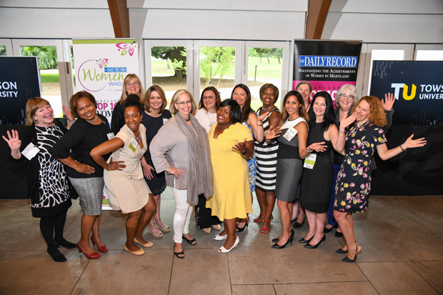 Top 100 Women winners have a little fun as they gather for a group photo during The Daily Record's Path to Excellence networking event at Towson University. (Photo by Maximilian Franz)