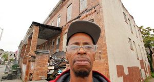 """""""It's a shame they couldn't fix them up and put families in them,"""" says Broadway East resident Cherry McDonald of the blight demolition program. """"But it's good because there was a lot of drug activity."""" (The Daily Record/Adam Bednar)"""