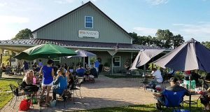 People enjoy outdoor seating at Romano Vineyard & Winery in Brandywine. (Submitted photo)