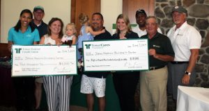 Members of the TowerCares Foundation Board of Directors present a check to Morgan Zacharetti, far left, and Cynthia Palacz, middle right, of Johns Hopkins Children's Center at the 37th Annual Tower Classic Golf Tournament June 7 at Renditions Golf Club in Davidsonville. Two-year-old twins Elle and Emme Thomas, the 2019 Children's Miracle Network Champions for Maryland, and their parents Kevin and Charissa Thomas , center, were special guests at the tournament. (Submitted photo)