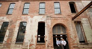 Developers, government officials and civic leaders were at the Hoen & Co. Lithographic Building project Monday to announce federal funding. (The Daily Record / Adam Bednar)