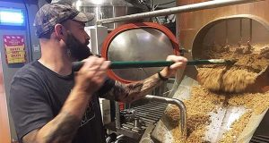 Jesse Johnson, co-owner of Brewery Fire in Taneytown, works on a brew. The brewery is scheduled to open in August. (Submitted photo)