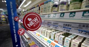 Signs advertise new products available inside a CVS store with the new HealthHUB in Spring, Texas. The drugstore chain's HealthHub stores will have about twice as much space devoted to health care as other locations. (AP Photo/David J. Phillip)