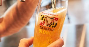 A beer is poured into a glass at the Guinness Open Gate Brewery and Barrell House in Halethorpe. (Submitted photo)