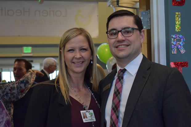 Stacy Magwire, director of community relations with Lorien Health Services in Taneytown, and Matt Kelley a regional sales director with Lorien, enjoy their time at the company's new logo unveiling event. (Photo courtesy of Lorien Health Services)