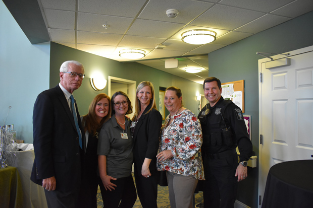 From left, Lorien Health Services Chief Operating Officer Wayne Brannock, Administrator Bernadette Beard, Assisted Living Life Enrichment Coordinator Verna Toms, Director of Community Relations Stacy Magwire and Director of Nursing Jennifer Mathis, RN get a photo with Taneytown Police Lt. Brian Costello. (Photo courtesy of Lorien Health Services)