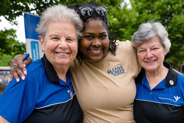 The Sisters of Bon Secours join in the fun to celebrate the launch of the Future Baltimore Mobile Market and Community Supported Agriculture program. From left are Sr. Mary Shimo, Congregation of the Sisters of the Blessed Sacrament (CBS); Shakira Foster, with Bon Secours Clean and Green Landscaping; and Sr. Anne Lutz, CBS. (Photo by Amy Deputy)
