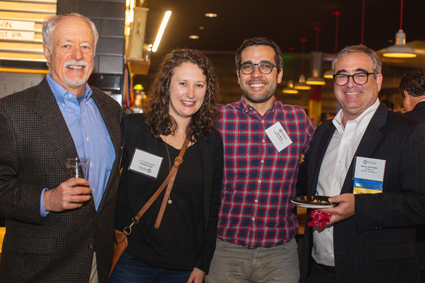From left, Thomas Minton and his wife Katie Minton, both partners at Goldman & Minton P.C.; Dan Mesa; and Marty Schreiber, a solo practitioner, enjoy the festivities. (Photo by Erik Hoffman, Petruzzo Photography)