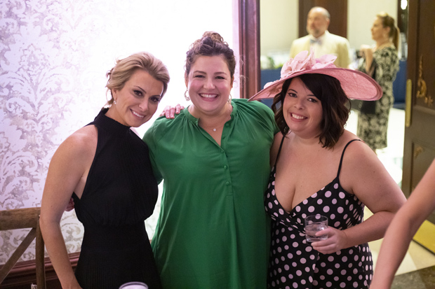 From left, Lisa Vogel, president of the Lisa Vogel Agency; Kohli Flick, owner and founder of Becket Hitch; and Emma Young attended the fourth annual Hats & Horses event. (Photo by Jason Putsché Photography LLC)