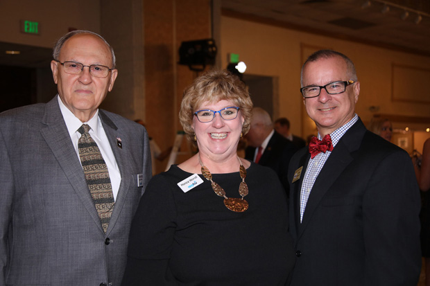 From left, Barry D. Decker, director of the Aberdeen Proving Ground Federal Credit Union Board of Directors; Monica Worrell, business development director at APGFCU; and Greg Pizzuto, executive director of Visit Harford, were on hand for the 42nd annual Military Appreciation Luncheon. (Photo by Mid-Atlantic Photographic)