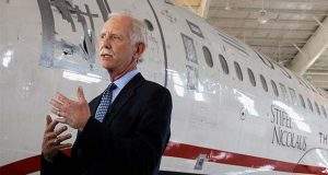 "FILE - In this June 11, 2011, file photo, former Capt. Chesley ""Sully"" Sullenberger talks to the media in front of the US Airways flight 1549 aircraft at the Carolina Aviation Museum in Charlotte, N.C. The president of the pilots' union at American Airlines says Boeing made mistakes in its design of the 737 Max and not telling pilots about new flight-control software on the plane. Sullenberger, the captain who safely landed a disabled jetliner on the Hudson River in 2009, is also expected to testify. He has said that Boeing was more focused on protecting its product, the Max, than protecting the people who use it. (AP Photo/Chuck Burton, File)"