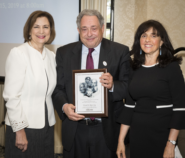 Howard R. Majev, center, partner at Saul Ewing Arnstein & Lehr LLP, accepts the Distinguished Pro Bono Volunteer Award, joined by Maryland Court of Appeals Chief Judge Mary Ellen Barbera, left, and Pro Bono Resource Center Executive Director Sharon E. Goldsmith. (Photo by Coos Hamburger/Focophoto)