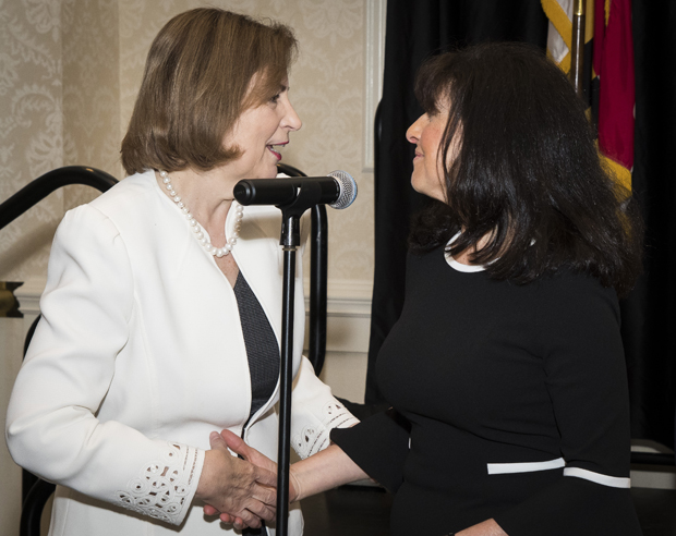 Maryland Court of Appeals Chief Judge Mary Ellen Barbera, left, and PBRC Executive Director Sharon E. Goldsmith greet one another at the presentation of Maryland Pro Bono Service Awards. (Photo by Coos Hamburger/Focophoto)