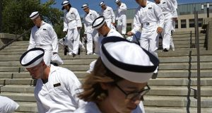 Incoming plebes carry their belongings down a staircase during Induction Day at the U.S. Naval Academy, in Annapolis. An analysis released Tuesday, July 23, 2019, shows the percentage of female students nominated by members of Congress for admission to U.S. service academies has been rising although men are still put forward at numbers nearly three times higher than women. (AP Photo/Patrick Semansky, File)