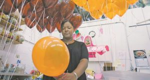 Candice Jeter fills orange and brown balloons with helium at The Pink Gorilla in Cleveland Thursday, Sept. 7, 2006. Party planners beware: a global but temporary helium shortage could deflate festive balloons this fall. The shortage affecting some suppliers results from a series of unconnected events, including delays in getting helium plants on line in Algeria and the Mideast, the U.S. Bureau of Land Management said. (AP Photo/Mark Duncan)