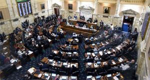 FILE This Monday April 8, 2019 file photo shows State delegates work in the Maryland House of Delegates chamber in Annapolis, Md. on the final day of the state's 2019 legislative session. Laws to protect students from sexual abuse, focus on high prescription drug costs and protect oysters in the Chesapeake Bay are among the new laws taking effect in Maryland this week. (AP Photo/Steve Ruark)