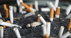 "FILE - This March 28, 2019, file photo shows cigarette butts in an ashtray in New York. Two of the hottest trends in investing are working in tandem to steer billions of dollars toward companies seen as the best corporate citizens. The sustainable investing field in its early days attracted investors by avoiding so-called ""sin stocks""-- gun makers, cigarette manufacturers, etc. (AP Photo/Jenny Kane, File)"