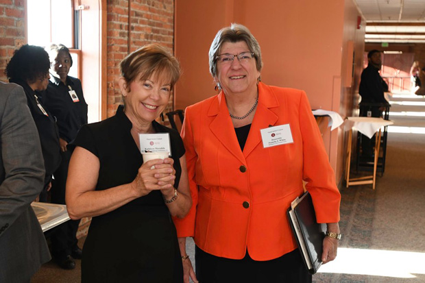 Kathleen Meredith, left, a partner with Iliff, Meredith, Wildberger & Brennan P.C., Attorneys at Law, gets a photo with the Hon. Pamela J. White, an associate judge on the Circuit Court of Baltimore City. (Photo by Eric Stocklin)