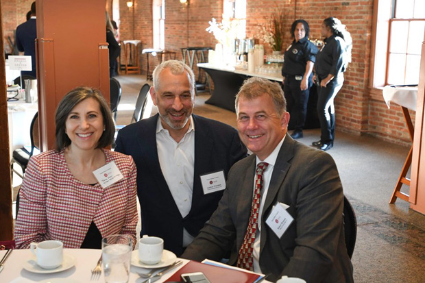 From left, Dana Gloor, a principal with Miles & Stockbridge; Andrew Freeman, a partner with Brown Goldstein Levy; and Robert Brennen, a principal with Miles & Stockbridge, enjoy their time at the 22nd annual Equal Justice Awards Breakfast. (Photo by Eric Stocklin)