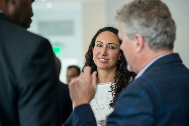 Melissa Gomez, a consultant with SHIFT, enjoys a conversation during the World Trade Center Institute's AGILE Innovation Program. (Photos by Tarja Savonen)