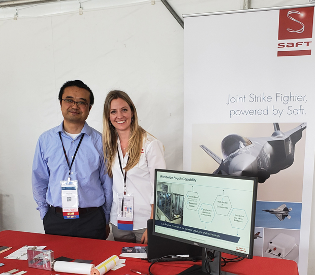 Dr. Xilin Chen, left, and Carine Margez discuss Saft batteries used in the Joint Strike Fighter program at Industry Day. (Photo courtesy of Saft Cockeysville)