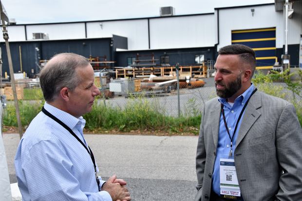 Scott Ferguson, Xcelion 6T global product manager with Saft, chats with James Kirschner, director of business development and sales with Go Electric at Saft's Industry Day event. (Photo courtesy of Saft Cockeysville)
