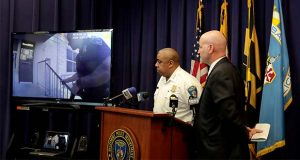 Baltimore Police Commissioner Michael Harrison, center, and Capt. Donald Diehl look on as the department makes public portions of footage from the body camera worn by Sgt. Billy Shiflett, who was shot while responding to an active shooter call at Baltimore addiction clinic at a news conference, Tuesday, July 23, 2019, in Baltimore. Shiflett was wearing a bulletproof vest but a bullet shot by a man demanding methadone struck his lower abdomen on July 15. The officer was released from the hospital over the weekend. (AP Photo/Julio Cortez)