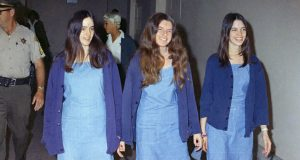 "FILE - In this Aug. 20, 1970, file photo, Charles Manson followers, from left, Susan Atkins, Patricia Krenwinkel and Leslie Van Houten walk to court to appear for their roles in the 1969 cult killings of seven people in Los Angeles. Atkins estified she was ""stoned on acid"" and didn't know how many times she stabbed Tate as the actress begged for her life. She died in prison of cancer at age 61 in 2009. Krenwinkel testified at a 2016 parole hearing that she repeatedly stabbed Abigail Folger, then stabbed Leno LaBianca in the abdomen the following night and wrote ""Helter Skelter,"" ″Rise"" and ""Death to Pigs"" on the walls with his blood. Krenwinkel, 71, remains in prison. She didn't take part in the Tate killings but accompanied Manson and others to the LaBianca home the next night where she held Rosemary LaBianca down with a pillowcase over her head as others stabbed her dozens of times. She has been recommended for parole three times but former Gov. Jerry Brown blocked her release each time.(AP Photo/George Brich, File)"