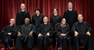 In this Nov. 30, 2018, file photo, the justices of the U.S. Supreme Court gather for a formal group portrait. Seated from left: Associate Justice Stephen Breyer, Associate Justice Clarence Thomas, Chief Justice of the United States John G. Roberts Jr., Associate Justice Ruth Bader Ginsburg and Associate Justice Samuel Alito Jr. Standing behind from left: Associate Justice Neil Gorsuch, Associate Justice Sonia Sotomayor, Associate Justice Elena Kagan and Associate Justice Brett M. Kavanaugh.  (AP Photo/J. Scott Applewhite)