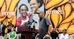 Congressman Elijah Cummings speaks at the grand opening of the McCullough Street Nature Play Space in West Baltimore on Saturday, Aug. 3, 2019.  Cummings on Saturday invited President Donald Trump and other Americans to Baltimore, taking the high road after a barrage of presidential tweets disparaging the black-majority city and its long-serving Democratic congressman. (Kim Hairston /The Baltimore Sun via AP)