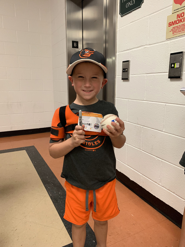 """Elijah Yanike is all ready to get autographs from Orioles' players at Camden Yards, thanks to SECU's """"K's for Kids"""" program. (Photo by Lina Bernstein)"""
