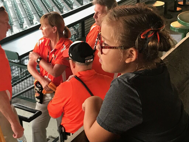 Olive Weidenhammer looks out onto the baseball diamond at Camden Yards as she waits to watch the Orioles take the field. (Photo by Lina Bernstein)