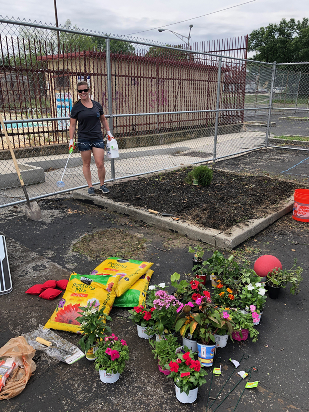 Sarah Sedlak, business development manager, helps with a gardening project at the Boys and Girls Club. (Photo courtesy of SC&H Group)