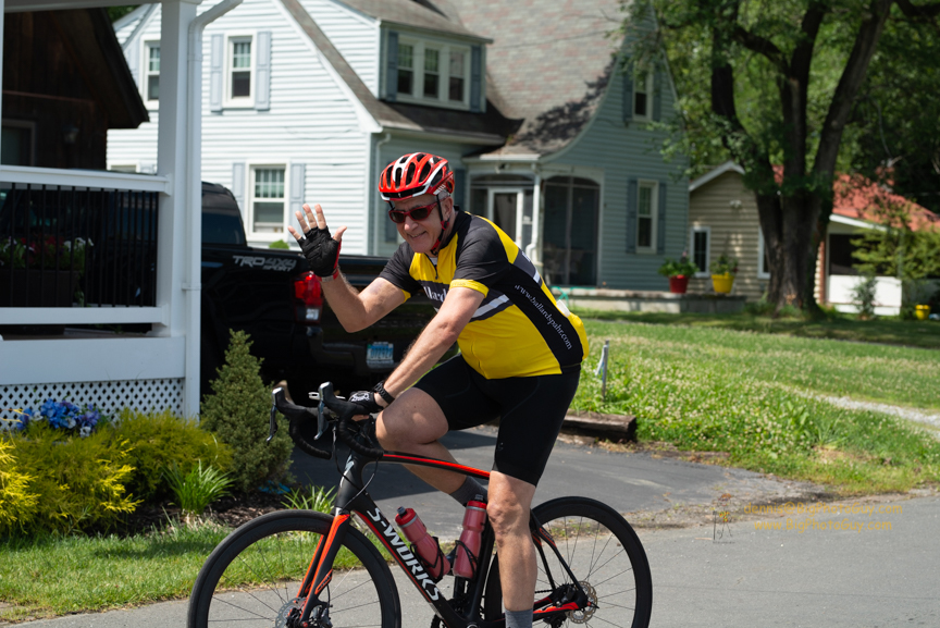 Roger Winston, a partner with Ballard Spahr, waves to the crowd during the ride. (Photo courtesy of Ballard Spahr)