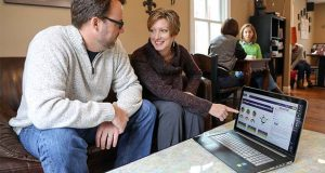 Debra Cancro, founder of VoiceVibes, right, poses with VoiceVibes software. (VoiceVibes photo)