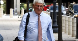 FILE - In this Aug. 22, 2019, file photo, Greg Craig, right, former White House counsel to former President Barack Obama, walks into a federal courthouse for his trial, in Washington. Craig was found not guilty of lying to the Justice Department about work he did for the government of Ukraine in a case that arose from the special counsel's Russia investigation and that centered on the lucrative world of foreign lobbying. (AP Photo/Patrick Semansky, File)
