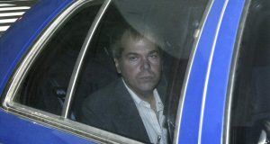 In this Nov. 18, 2003, file photo, John Hinckley Jr. arrives at U.S. District Court in Washington. Hinckley, who tried to assassinate President Ronald Reagan in 1981, is now interested in getting a job in the music industry, possibly in California, according to his lawyer. A prosecutor said that would give the government 'great pause.' (AP Photo, Evan Vucci)