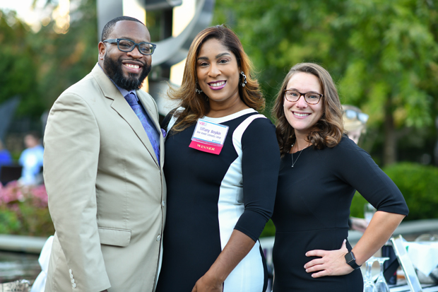 2019 VIP List winners Tiffany Boykin, center, of Anne Arundel Community College; and Annette Wallace, left, of Worcester County Public Schools, stand with Aram Boykin. (Photo by Maximilian Franz)