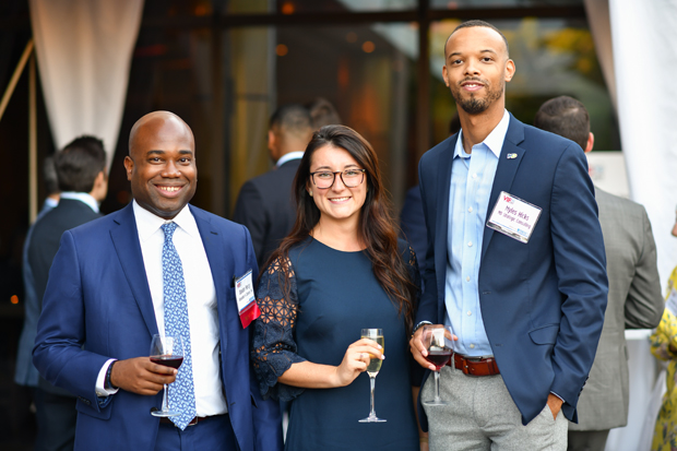 2019 VIP List winner Davion Percy, left, of Alexander & Cleaver, PA, visits with Rylie Shewbridge, of Alexander & Cleaver, PA; and Myles Hicks, of MD Strategic Counsulting. (Photo by Maximilian Franz)