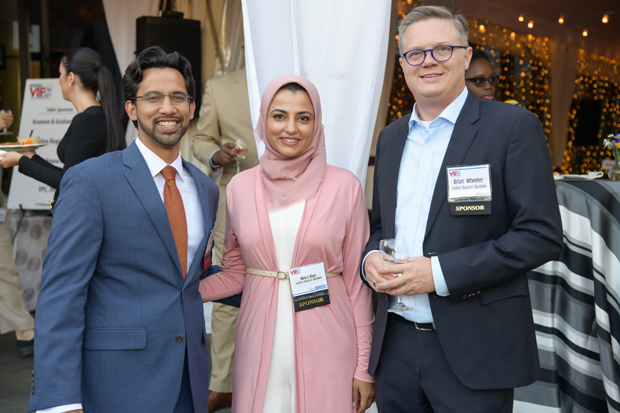 Arif Khan, left, a 2019 VIP List winner, stands with Nimra Khan and Brian Wheeler of CareFirst BlueCross BlueShield who was the reception sponsor of the event. (Photo by Maximilian Franz)
