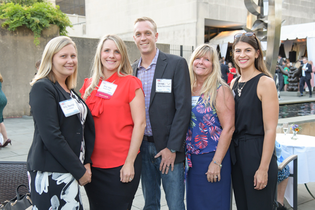 2019 VIP List winner Erica Starr, Howard Bank, stands with Kelly Rawleigh, Howard Bank; Christopher Starr, Full Keel Marine Services; Donna DiCerbo, Maryland Transportation Authority; and Molly Melendez, Howard Bank. (Photo by Maximilian Franz)