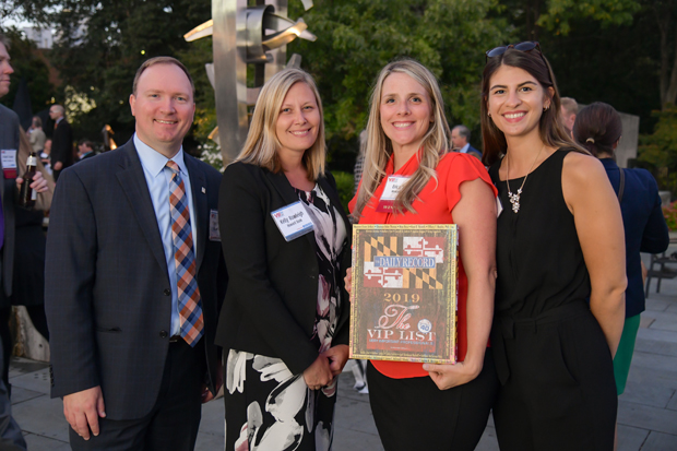 2019 VIP List winner Erica Starr, second from right, from Howard Bank, poses with her award along with Howard Bank colleagues Steve Poynot, Kelly Rawleigh and Molly Melendez. (Photo by Maximilian Franz)