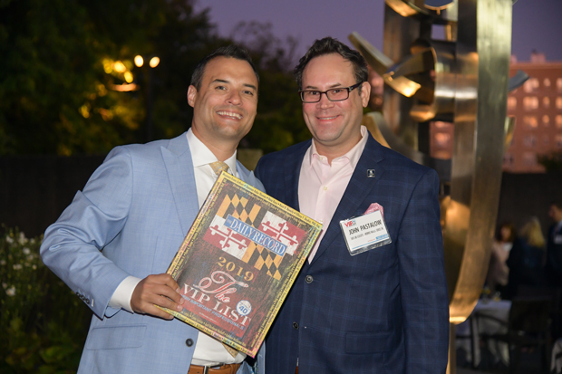 2019 VIP List winner Robert Titelman Jr., left, of Skylight Creative Ideas, stands with John Pastalow, of Shuck and Associates, Ameriprise Financial Services, Inc., visit during the event. (Photo by Maximilian Franz)
