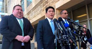 FILE - This Feb. 21, 2019, file photo shows U.S. Attorney Robert Hur, center, of the District of Maryland, speaks as Art Walker, left, special agent from the Coast Guard investigative service, and Gordon Johnson, special agent in charge of the FBI's Baltimore office, listen during a news conference about Coast Guard Lt. Christopher Hasson, outside the federal courthouse in Greenbelt. A federal judge said Monday, Sept. 9, that he will decide by the end of this week whether to dismiss gun charges against Hasson, accused of stockpiling combat gear and compiling a hit list of prominent Democrats and TV journalists. (AP Photo/Michael Kunzelman, File)
