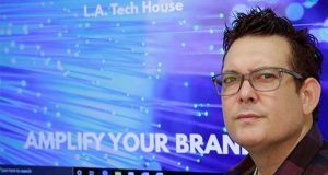 "In this Tuesday, Sept. 17, 2019 photo, Gabe Uribe, co-owner of L.A. Tech House, a public relations firm that focuses on tech companies, poses in his office in Beverly Hills, Calif. When he began advertising online, he went with the common wisdom that the more spent on Google ads, the better the results. But he learned he could cut his budget and be fine. ""If you put some strategy into it, you have a good chance of going up against the big guys,"" Uribe says. ""We own our little corner with tech PR."" (AP Photo/Damian Dovarganes)"