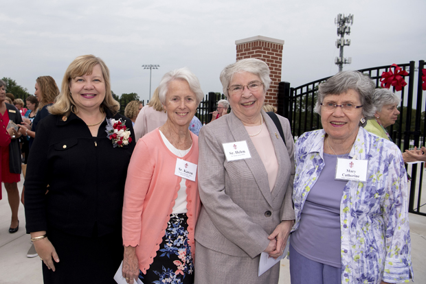 From left, Mary Beth Lennon, president of Mercy High School and a 1985 alumna of the school; Sister M. Karen McNally, RSM, chief administrative officer of Stella Maris Inc.; Sister Helen Amos, RSM, executive chair of the board of trustees of Mercy Medical Center; and philanthropist Mary Catherine Bunting attended the dedication and blessing of the Sisters of Mercy Athletic Complex. (Photo by Larry Canner Photography)