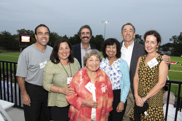 "Members of the Mangione family, who were significant donors to the construction fund which helped build the Sisters of Mercy Athletic Complex, gather for a photo at the dedication and blessing ceremony. Shown are, top row, from left, Pete Mangione; John ""Dino"" Mangione Sr.; Joe Juras; and Tracy Dolan Mangione, a 1982 Mercy High alumna; Center, Joanne Hock Mangione and Rosemary Mangione Juras, a 1969 graduate; and front, Mary Mangione. (Photo by Larry Canner Photography)"